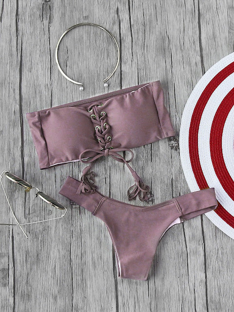 http://it.shein.com/Eyelet-Lace-Up-Tassel-Bandeau-Bikini-Set-p-352834-cat-1866.html?utm_source=unconventionalsecrets.blogspot.it&utm_medium=blogger&url_from=unconventionalsecrets