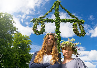 Pic of 2 girls with flowers in their hair for Midsummer Celebration on sunny day