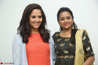 Actress Suma in Black Salwar Suit and Anusuya in orange Dress at winner movie press meet part 1 February 2017 (12).JPG