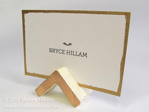 Handmade geometric triangle wedding place card holder