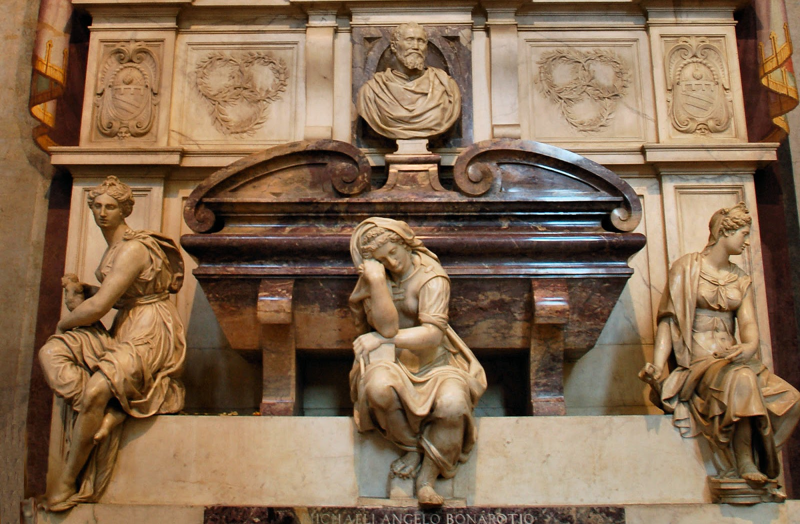 Close-up view of Michelangelo's tomb: Sculpture, Painting and Architecture personified appear below the creative genius at top. Photo: WikiMedia.org.