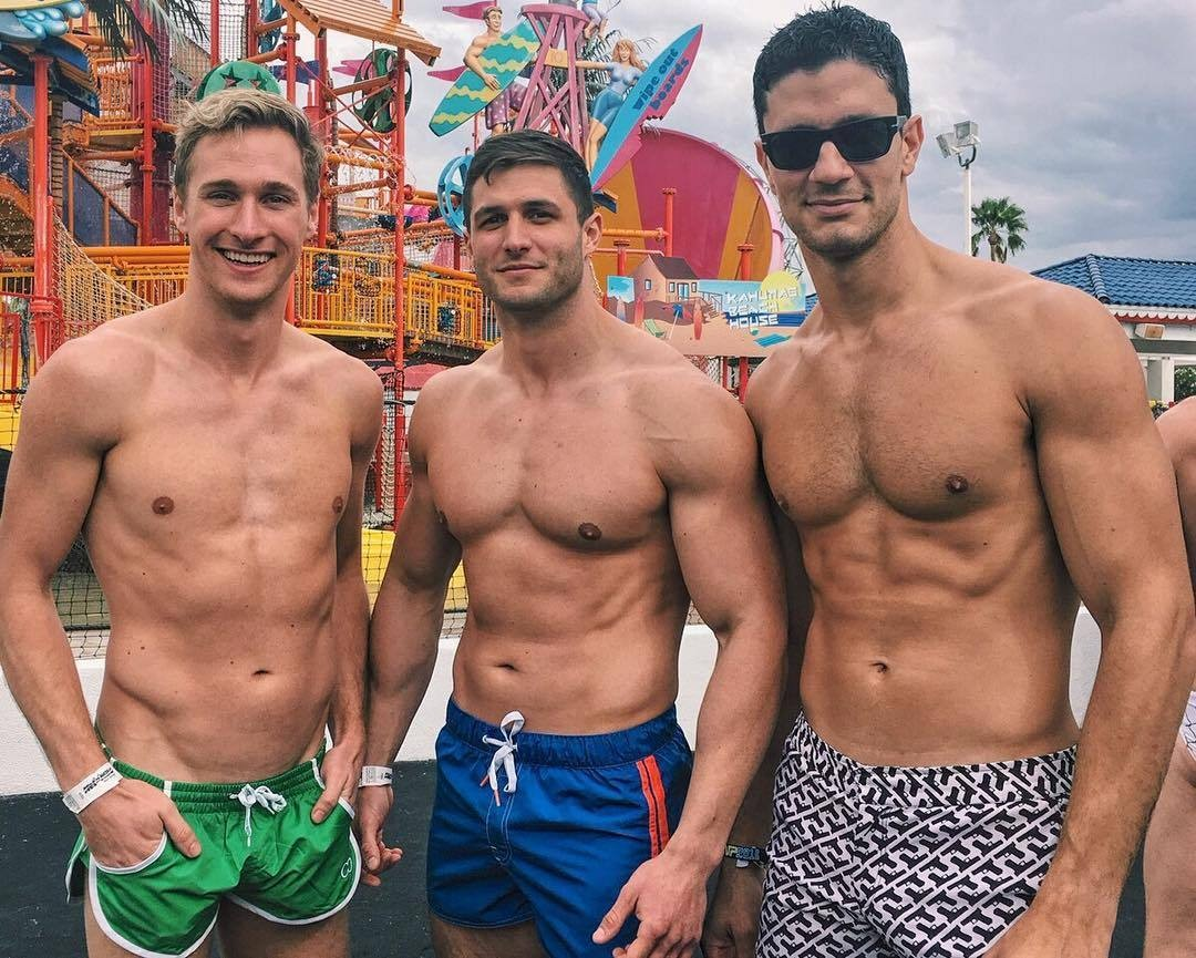 buff-shirtless-men-amusement-park