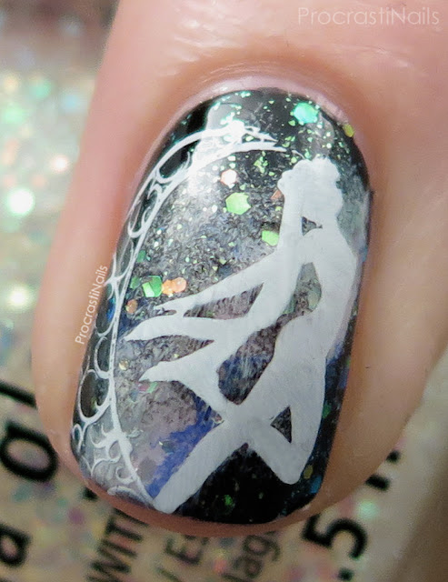 Macro of a galaxy manicure with Sailor Moon stamped on top