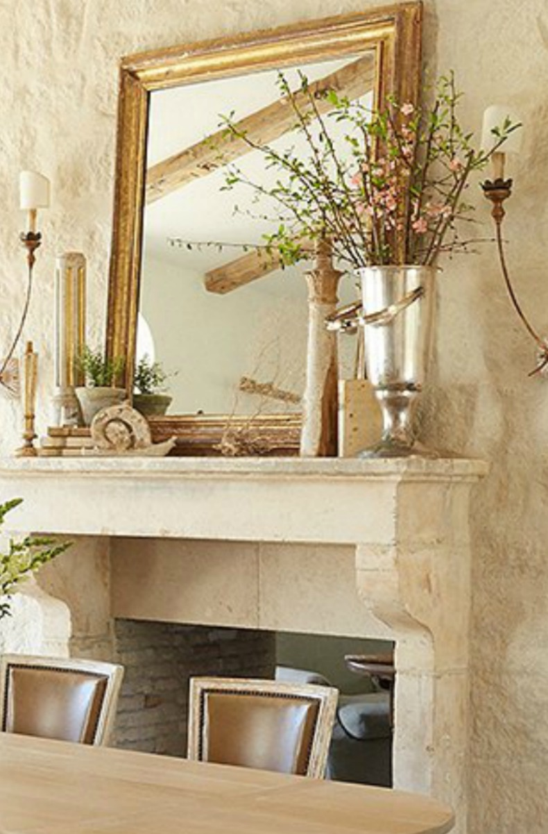 #Frenchcountry decor in French limestone fireplace with gilded mirror in #PatinaFarm dining room #modernfarmhouse