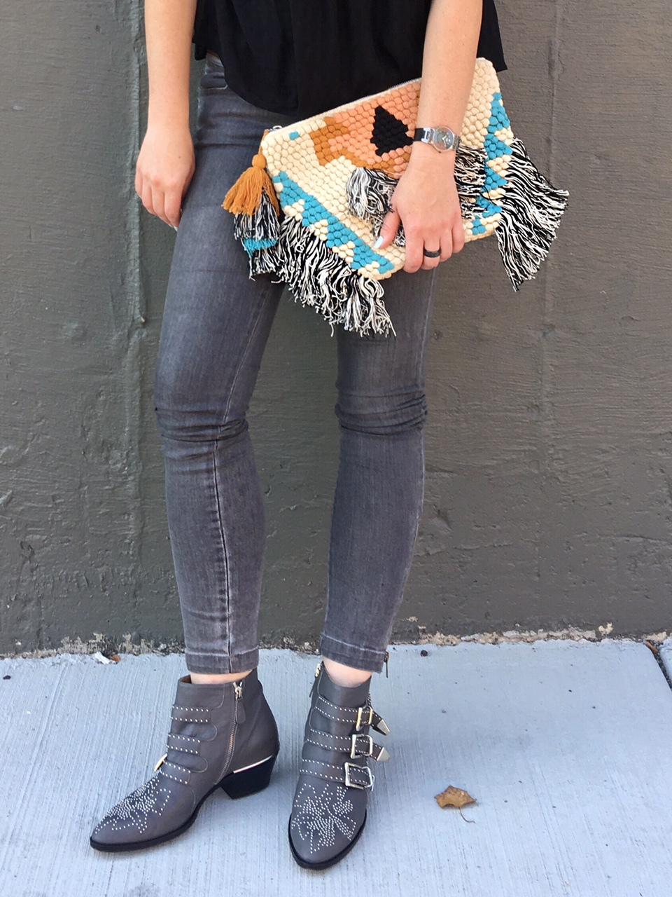 Black lace top and ethnic clutch