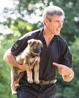 Paul carrying Ash the puppy