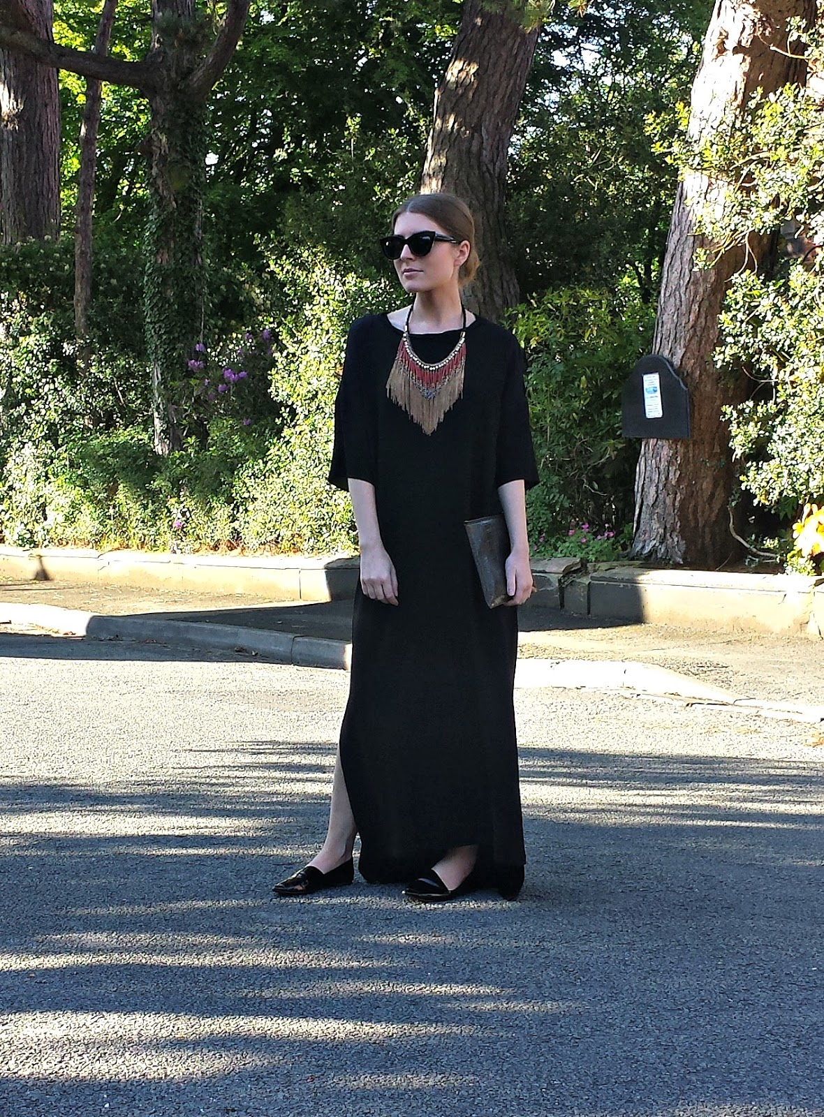 ec656dc2196 Style Trunk   Outfit  Black Maxi Dress and Statement Necklace