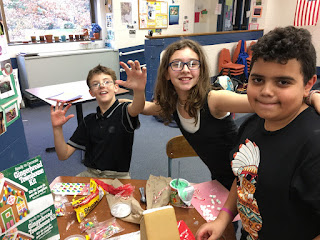 Our 5th Graders Making Gingerbread Houses