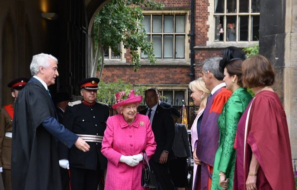Queen Elizabeth wore a floral satin dress, pink coat and pink hat, pearl necklace, pearl earrings and diamond brooch