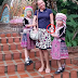 Girl-child stolen tourist's wristwatch while posing for photos with her in Thai dress in Chaingmai.