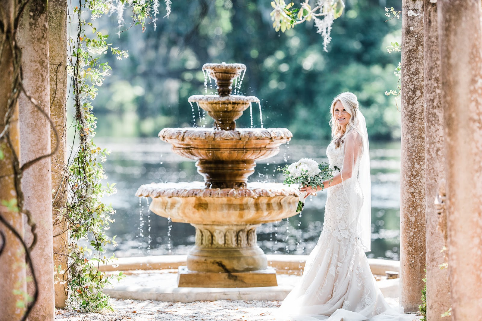 Bride in her wedding dress a the pergola fountain in Airlie Gardens in Wilmington NC - Wedding photography - Airlie Gardens Weddings