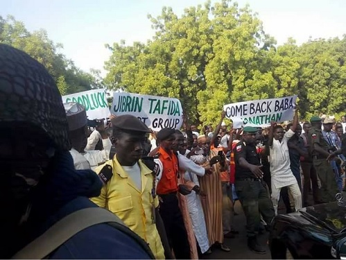 "RECESSION: See Photos of Suffering Northern Youths Mob Jonathan Excitedly In Sokoto, Placard ""Sai Jonathan Come Back Again"""