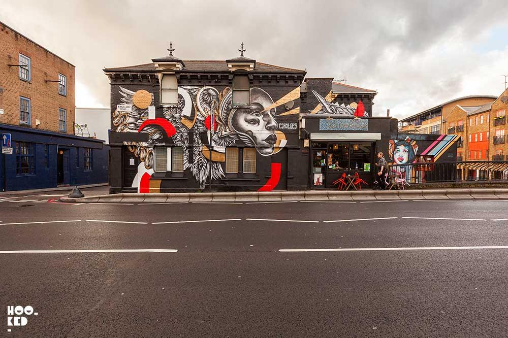 Artist Caratoes Street Art Mural in Haggerston, London.