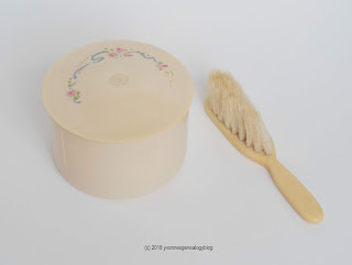 Vintage baby brush and talcum powder canister