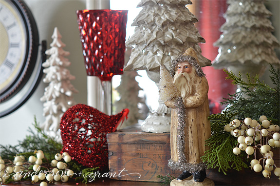 Vintage looking santa on a Christmas mantel | www.andersonandgrant.com