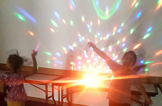 children dancing in colored lights