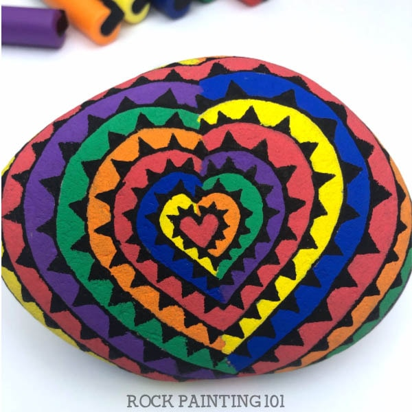Rainbow painted rocks - how to paint a spiral heart with rainbow colors on a painted rock