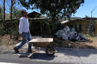 Worker on side of road in Costa Rica.