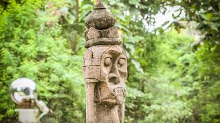 sad face asmat statue