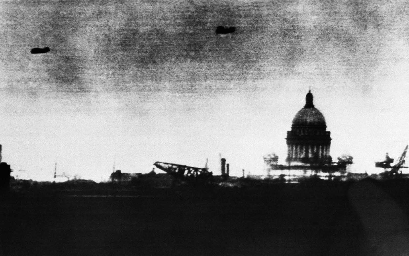 German officials claimed that this photo was a long-distance camera view of Leningrad, taken from the Germans' seige lines, on October 1, 1941, the dark shapes in the sky were identified as Soviet aircraft on patrol, but were more likely barrage balloons. This would mark the furthest advance into the city for the Germans, who laid seige to Leningrad for more than two more years, but were unable to fully capture the city.