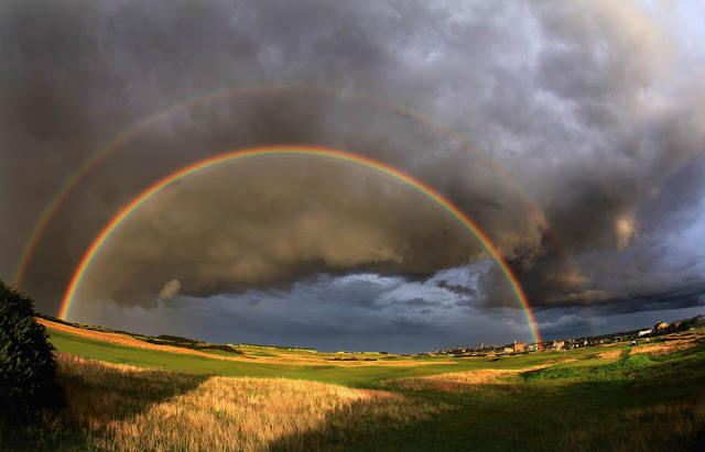 A rainbow on a very stormy evening behind the green on the Old Course in St. Andrews, Scotland.