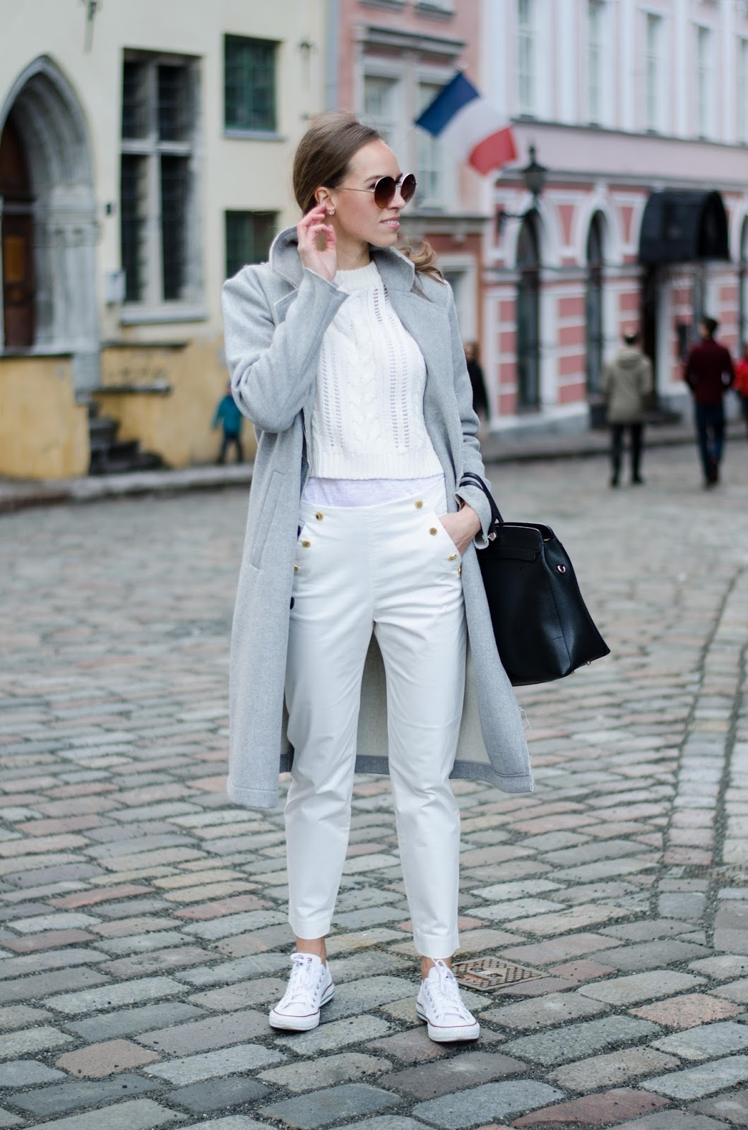 kristjaana mere spring white outfit cropped jumper pants converse snerakers gray coat minimalist fashion