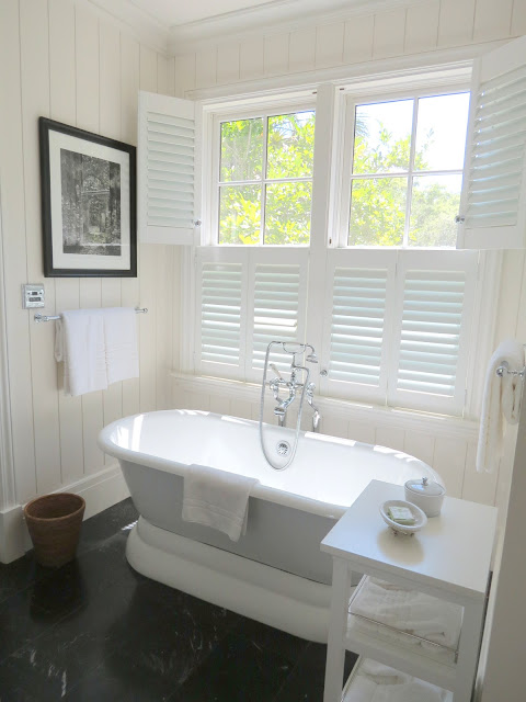 where to place soaking tub in bath under window