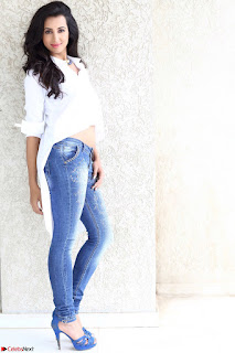 Sanjjanaa Galrani Looks Fabulous in Washed out Denim jeans and White Shirt.jpg
