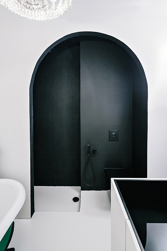 Black arched shower by Crosby Studios