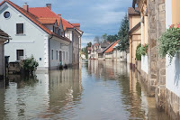 Flooded street. (Credit: © kasto / Fotolia) Click to Enlarge.