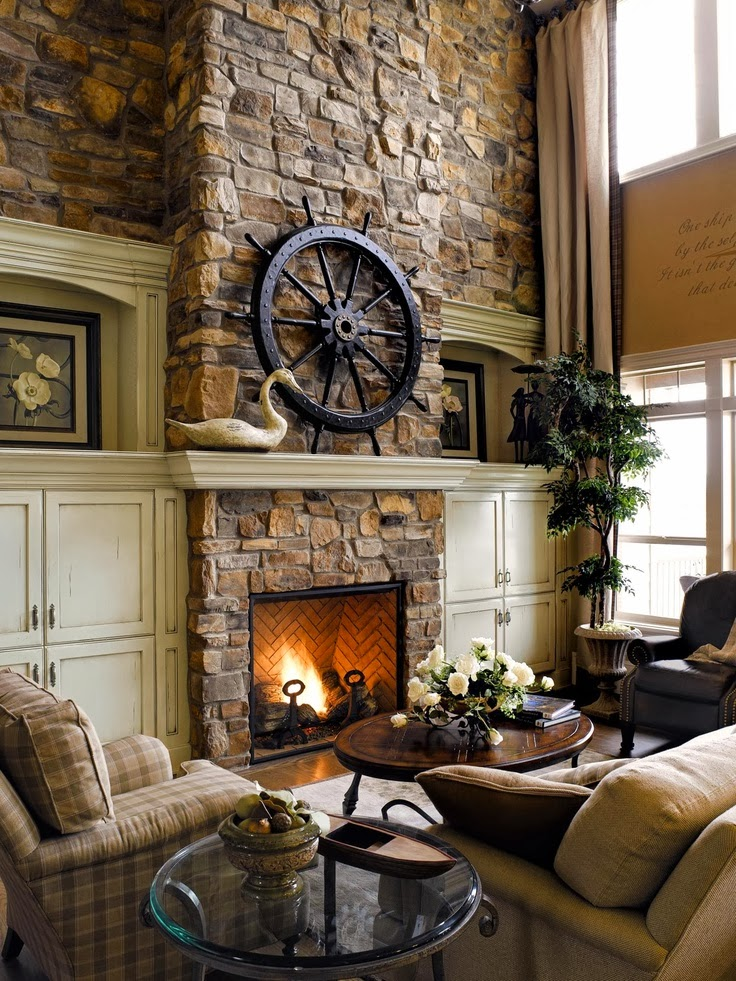 A cozy fireplace the focal point of the room - Stone and wood fireplace ...