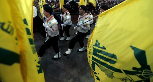 Image Attribute:  The file photo of Hezbollah's Mahdi Scouts participate in a parade in Beirut's southern suburbs as part of Quds Day on July 25, 2014. Al-Akhbar /Haitham Moussawi / CC-BY-NC-ND-3.0