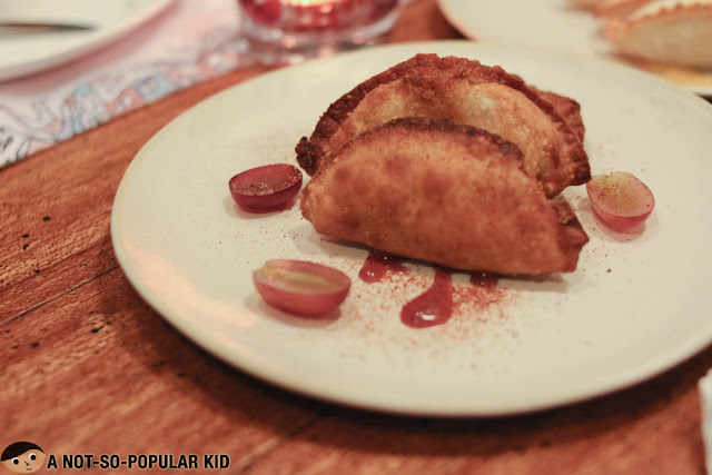 Lechon & Grape Jam Empanada of Rambla