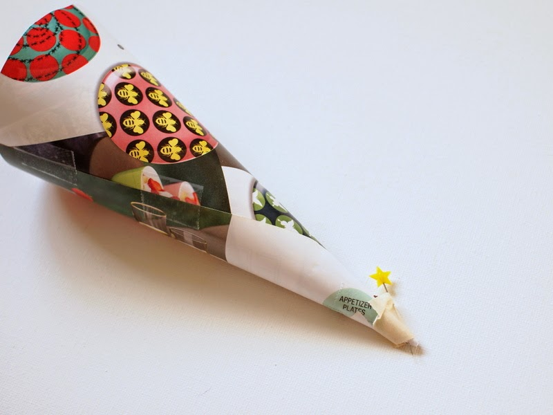 make a paper cone and poke a straight pin through the pointy end