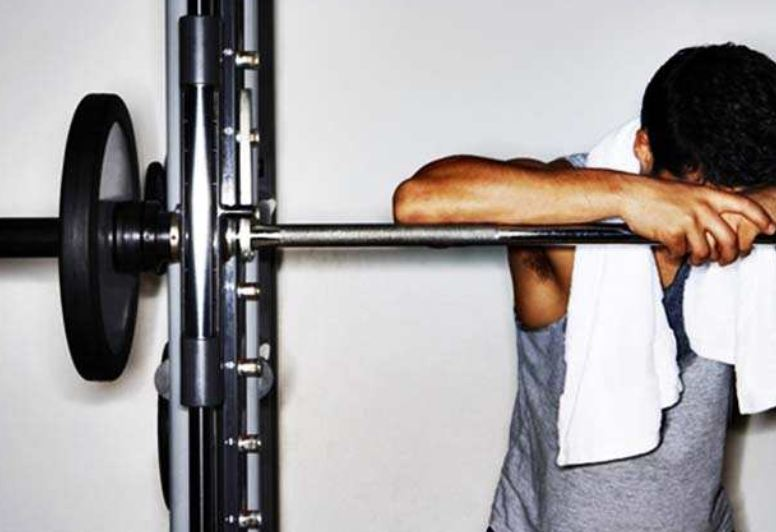 Man bent over squat rack | www.THEFITTESTBLOGGER.com
