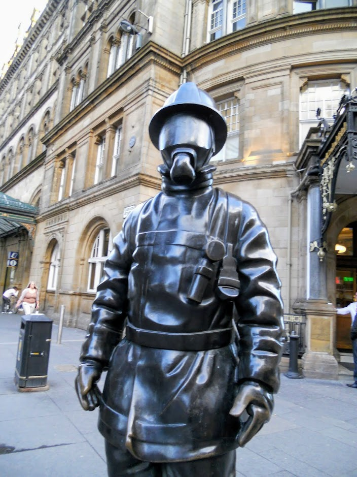 Things to do in Glasgow City: sculpture wearing a gas mask in Glasgow Scotland
