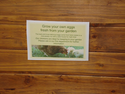 Sign on a Chicken House, saying Grow your own Eggs
