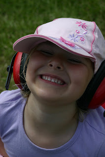 Grinning Top Ender wearing Ear Defenders