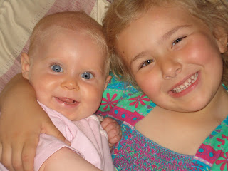 Top Ender and Baby Cousin smiling at the camera