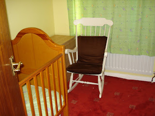 The Rocking Chair in Baby Boys room near his cot