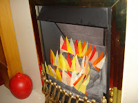 Paper Flames in a fireplace