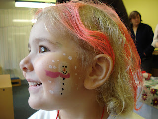Top Ender with a painted Snowman on her cheek and red streaks in her hair