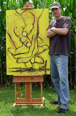 Dennis Ryan standing next to his 3 foot wide by 4 foot high fine art painting titled Mellow Yellow