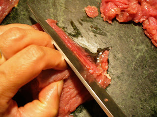Shredding beef for stirfry with sharp knife