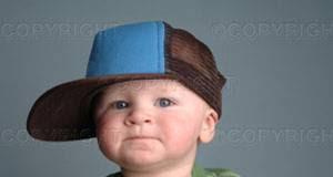 boy in sideways ball cap