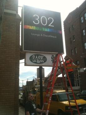 302 sign gets installed