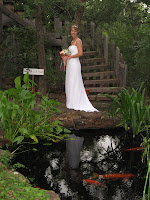 Bride standing by the water pond