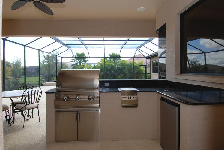 A Beautiful Florida Home The Outdoor Living Area Pool Lanai Outdoor Kitchen of a Beautiful