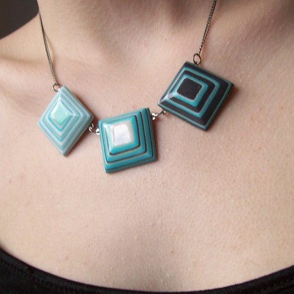 layered blue paper squares on a necklace