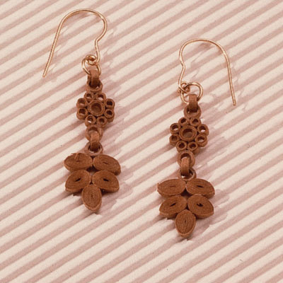 ornate quilled earrings made of cardboard